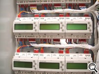 A bank of rail-mounted meters,